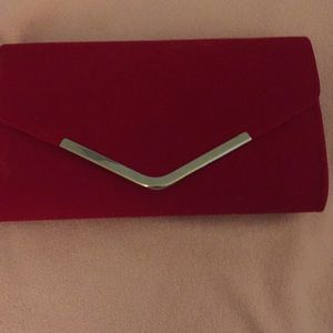 Handbags - Red velvet clutch.